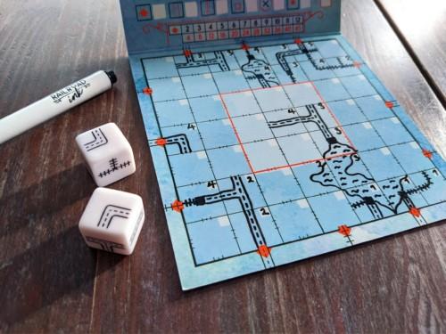 Pelaajan pelilauta, johon on piirretty reittejä, ja kaksi noppaa